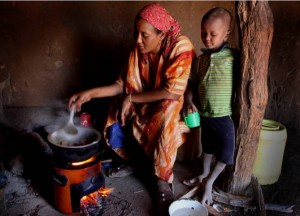 woman in kenya using a stove from the paradigm project